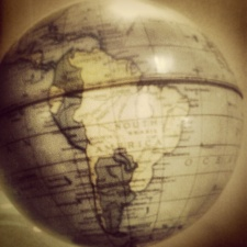 Early 20th-century metal globe showing South America