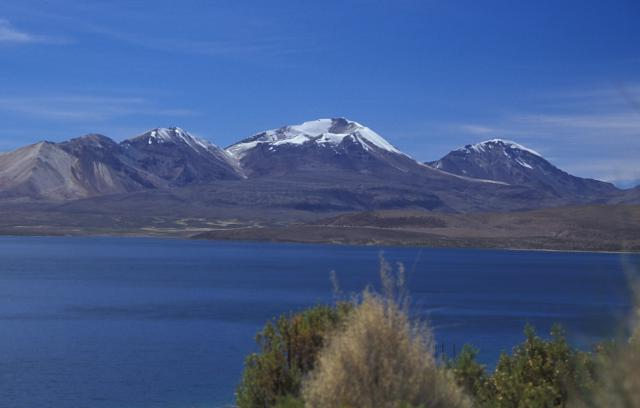 From left to right, 5730-m-high Volcán Humarata, 6052-m-high Volcán Acotango, and 5990-m-high Cerro Capurata volcanoes Credit: Lee Siebert, Smithsonian Institution [Public domain], via Wikimedia Commons